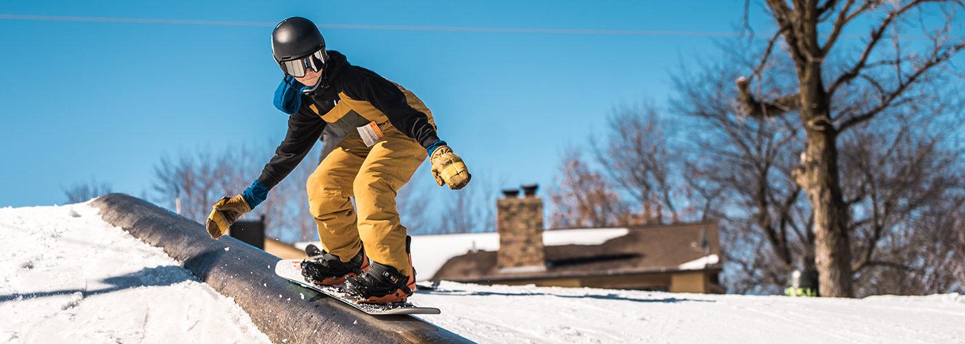 Buck Hill Ski & Snowboard Area - Snowboarder on rail